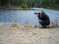 Jocke med fotograferingsapparaten